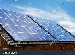 solar panels on roof modern solar panels on house roof stock photo 129267356 shutterstock