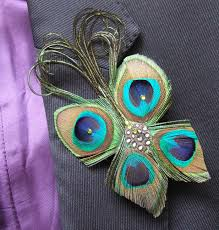 bridal wedding boutonniere lapel pin peacock feathers butterfly with