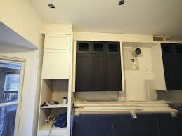 kitchen cabinets top trim dealing with out of level kitchen ceilings jlc