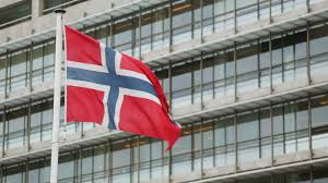 the flag of norway waving before an office building stock video