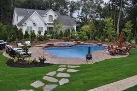 landscaped backyard design with free form vinyl pool spillover