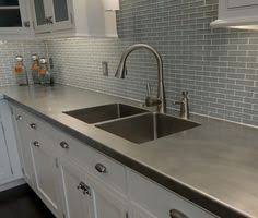 stainless steel countertop with built in sink q a architect client cook up a gorgeous functional kitchen