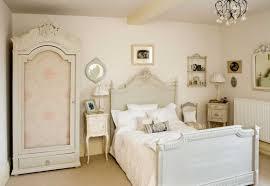 modern vintage bedroom wooden bedside tables green floral duvet bedroom modern vintage white cream floral duvet black high tufted headboard mounted low wooden bedside tables