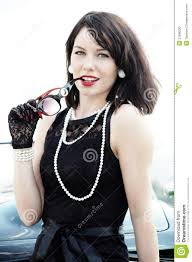 pearl necklace woman images Beautiful woman in black dress and pearl necklace stock photo jpg