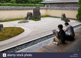 couple sitting on veranda at daitokuji temple ryogenin dry