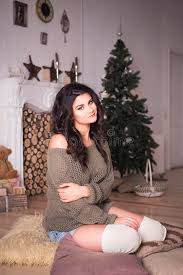 new years shorts beautiful woman in shorts and sweater in new year decor