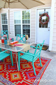 Painting An Outdoor Rug Patio With Colorful Outdoor Patio Reveal Rug And Light