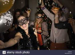 mask party woman in masquerade mask enjoying new years party stock photo