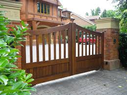 wooden gate entrance designs for homes with red brick and elegant