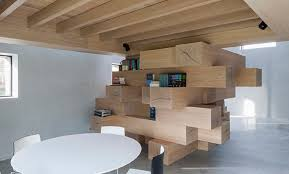 stacked timber beams act as multi use office furniture in this