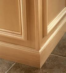 kitchen island molding cove baseboard molding installed at base of floor cabinets at