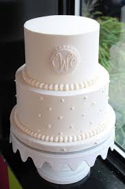 cake monograms monogrammed wedding cake monogram wedding monograms and navy ribbon