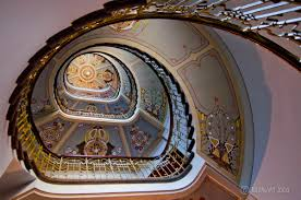 interior classic helical stairs with art nouveau ceiling design