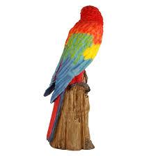 wonderland scarlet macaw sitting on tree