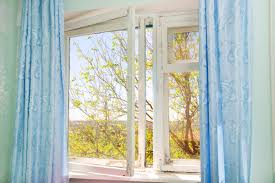 Hanging Curtains High And Wide Designs Window Dressing How To Decorate An Window Reader S Digest