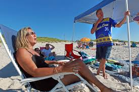 heslam amorous action shocks cape cod beachgoers boston herald