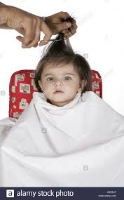 baby girl hair portrait of a baby girl getting a hair cut stock photo 9611430
