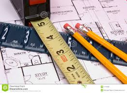 measuring tape and ruler with pencils on house floorplan royalty