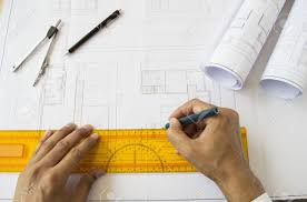 architect designing a plan of a house stock photo picture and
