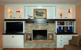 home design modern wall storage around a fireplace for more on