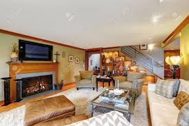 family room with comfort sitting area fireplace and tv in