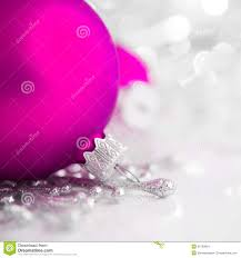silver and purple ornaments on bright background