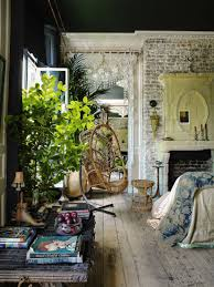boho vintage interior loving room exposed brick swinging wicker