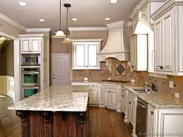 How To Antique White Kitchen Cabinets by Antique White Kitchen Cabinets With Granite Countertops Designs