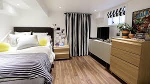 Basement Finishing Costs by Stylish Basement Into Bedroom Ideas With Basement Finishing Costs
