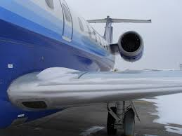 and snow on embraer 145 wing root photo credit chris schock