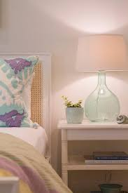 white tiered nightstand with cane headboard cottage bedroom
