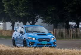 blue subaru 2017 driving the goodwood festival of speed hill climb in a 2016 subaru