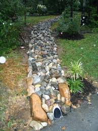 landscaping drainage with river rock backyard and yard design
