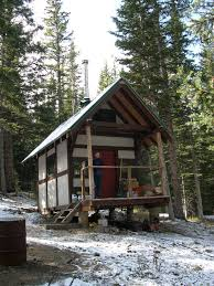 Timber Frame Cottage by The Timber Framed Cabin Project