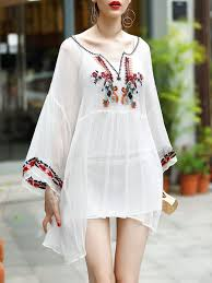 white bell sleeve embroidered sweetheart boho holiday dress