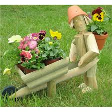 wooden garden flowerpot gardener with wheelbarrow the