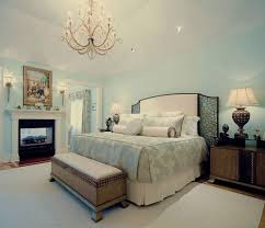 classic chandelier visually complements the painted ceiling of the stunning light blue and white master bedroom with classic chandelier ideas