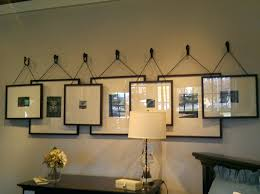 hanging photo frames with ribbon picture on plaster walls wall