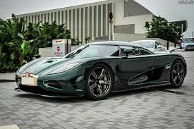 koenigsegg all cars green carbon fiber koenigsegg agera s and silver pagani huayra in