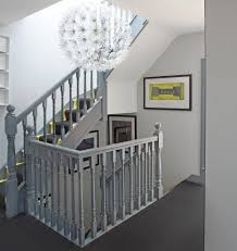 banister staircase transitional with open floor plan metal railing