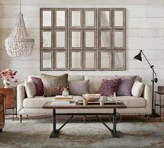 Decorating A Sofa Table Behind A Couch An Idea For Decorating The Wall Behind Your Sofa Driven By Decor