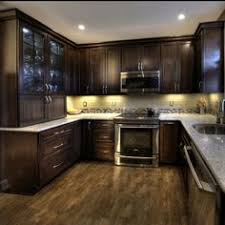 Small Kitchen With Dark Cabinets Like The Tone Of The Rustic Knotty Alder Kitchen Cabinets Would