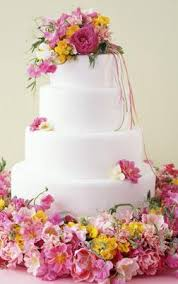 one stop wedding wedding cakes with flowers on top