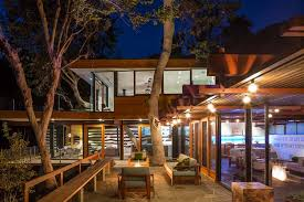 la mid century modern home with trees growing through it