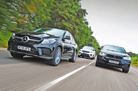 mercedes jeep gold mercedes gle coupe vs bmw x6 u0026 range rover sport auto express