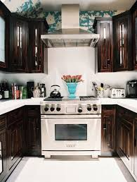 blue kitchen walls with brown cabinets chocolate cabinets eclectic kitchen lonny magazine
