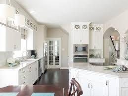 white kitchen arched doorway brushed nickel hardware clerestory