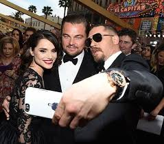 tom hardy and his gorgeous wife charlotte riley taking a picture