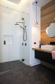 434 best bathroom accessible universal design wetrooms images on jamie hayden s main bathroom uses the gorgeous firenze nero hexagon tile