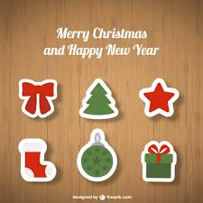 christmas ornaments on wooden background vector free download